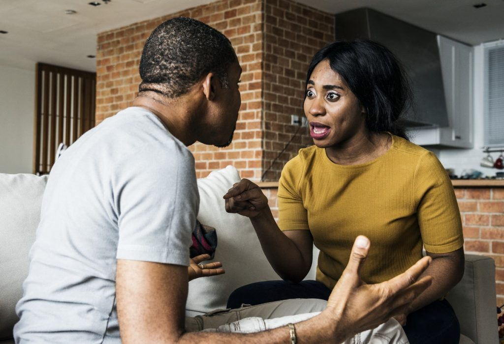 Signs you're sabotaging yourself - A man and a woman having an argument.